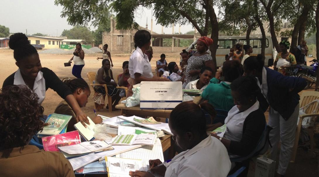 Local nurses supervise a group of students doing Nursing internships in Ghana during a medical outreach.